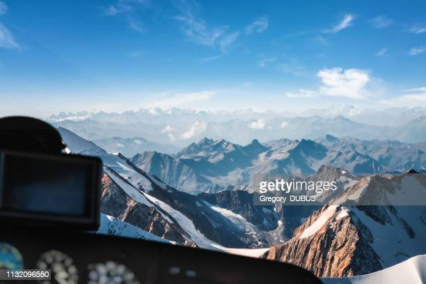 looking at mont blanc massif in french alps mountains through helicopter cockpit window aerial view - auvergne rhône alpes stock pictures, royalty-free photos & images