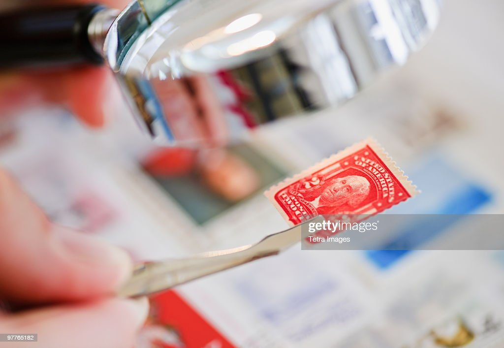 Looking at stamp : Stock Photo