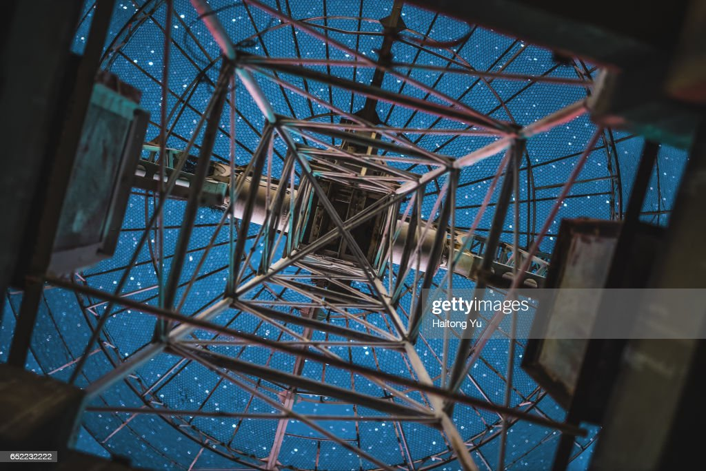 Looking at starry sky from below a radio telescope antenna : Stock Photo