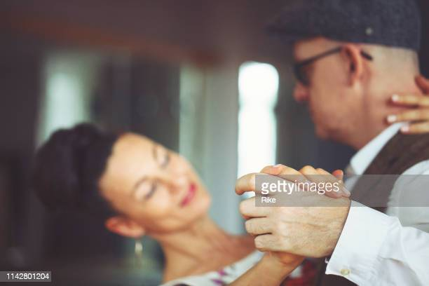 looking at the hand position of the dancing couple - duet stock pictures, royalty-free photos & images