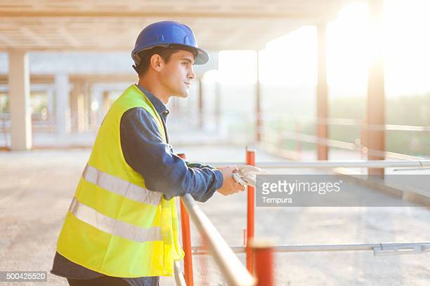 Looking at the job accomplished after hard day of work