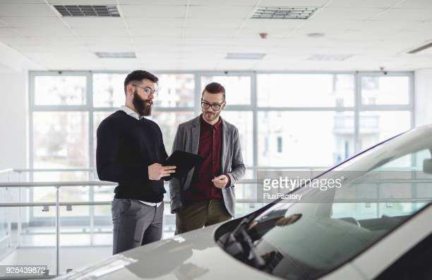looking at the new model - car ownership stock pictures, royalty-free photos & images