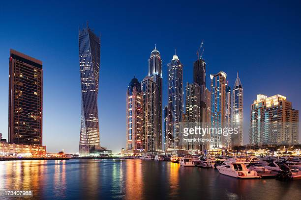 Looking at the port of Dubai Marina to the Blue Hour on the skyline