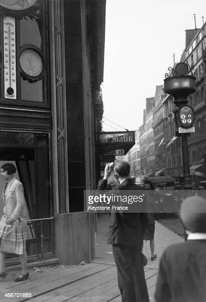 Looking at the thermometer during the heat wave in July 1929 in Paris France