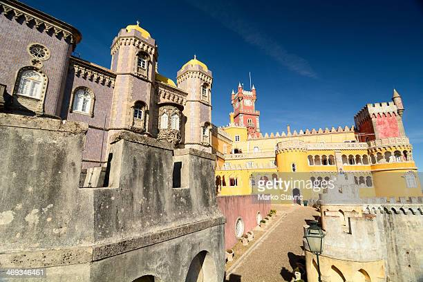 CONTENT] Looking at the towers of the Pena Palace a UNESCO World Heritage Site next to the town of Sintra