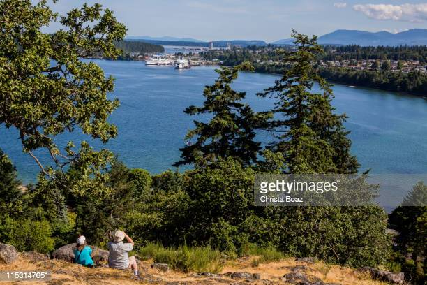 looking at the view on sugarloaf mountain - passenger craft stock pictures, royalty-free photos & images