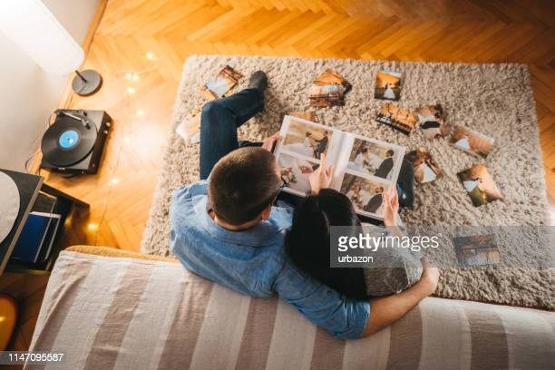 looking at wedding photos - photo album stock pictures, royalty-free photos & images