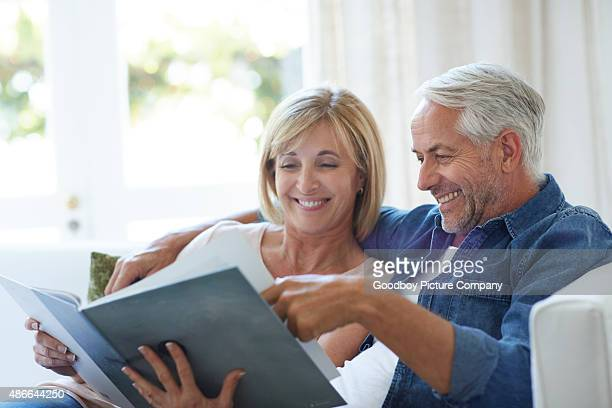 looking back at the good old days - photo album stock photos and pictures