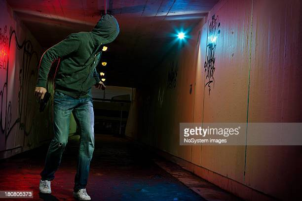looking back thief - criminal stock pictures, royalty-free photos & images