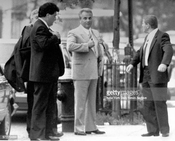 Looking cool even on a hot day reputed mob boss John Gotti is the center of attention yesterday as he arrives for the funeral of bodyguard Anthony J...