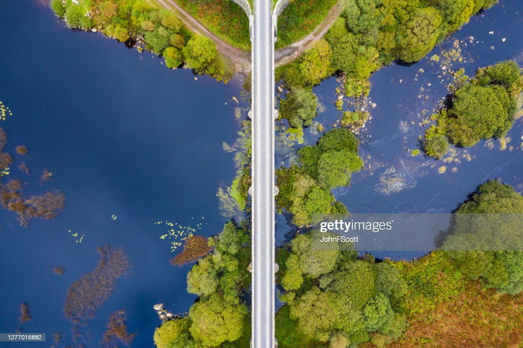 Looking directly down on a disused railway viaduct in rural Scotland : Stock Photo