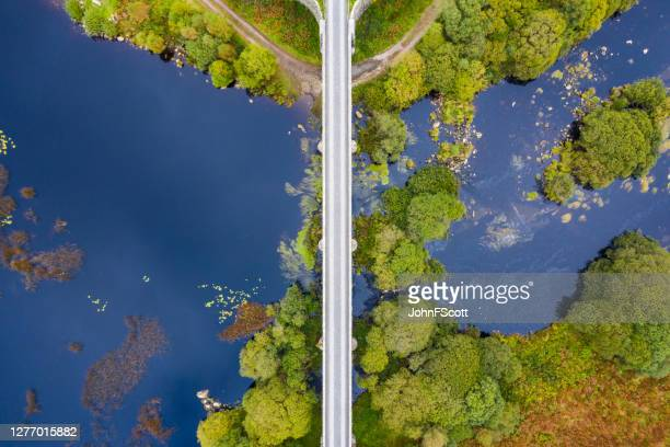 looking directly down on a disused railway viaduct in rural scotland - johnfscott stock pictures, royalty-free photos & images