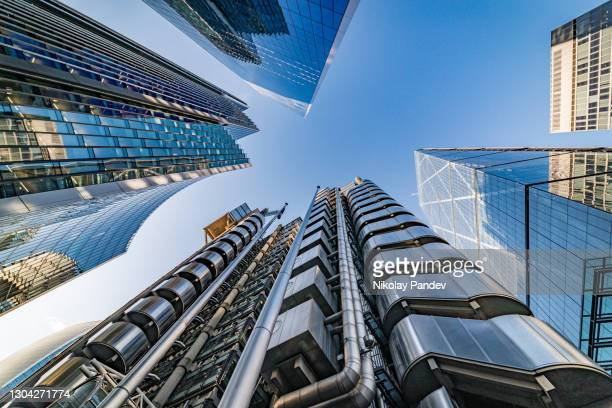 looking directly up at the skyline of the business and financial district in central london, uk - creative stock image - london stock pictures, royalty-free photos & images