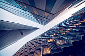 Looking directly up at the skyline of the financial district in central London - stock image