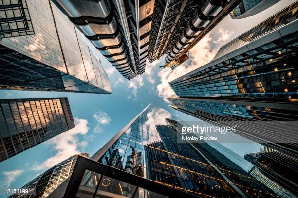 looking directly up at the skyline of the financial district in central london - stock image - corporate business stock pictures, royalty-free photos & images
