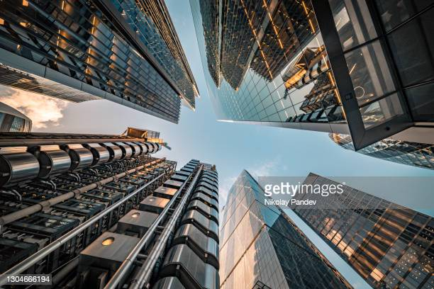 looking directly up at the skyline of the financial district in central london - creative stock image - looking up stock pictures, royalty-free photos & images