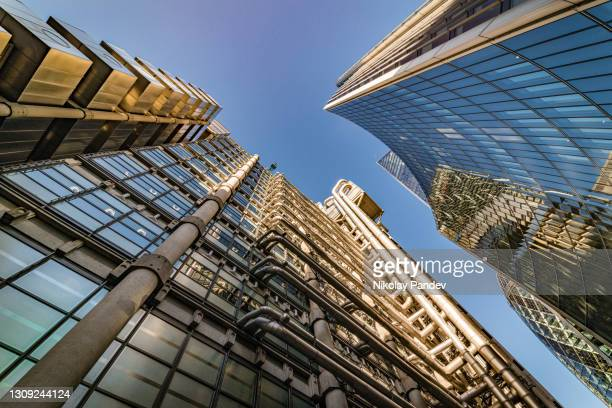 looking directly up at the skyline of the financial district in central london, unitaed kingdom - creative stock image - 2021 stock pictures, royalty-free photos & images