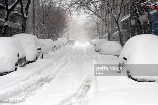 looking down a road full of snow covered cars  - blizzard stock pictures, royalty-free photos & images