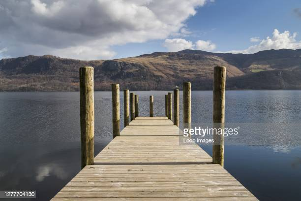 Looking down a wooden landing stage on Derwent Water.