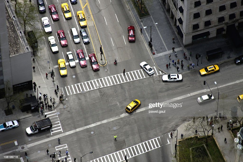 Looking Down At Downtown Intersection with Cars : Stock Photo