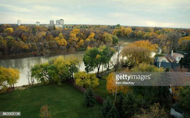 Looking down at fall scene & river from our balcony