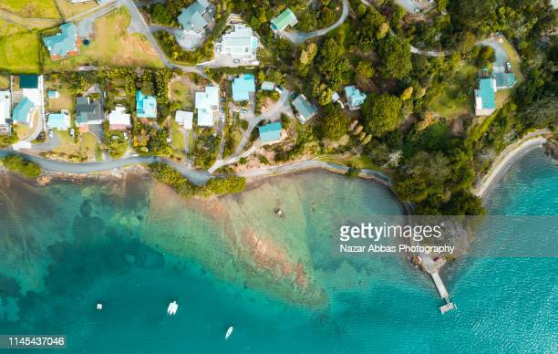 looking down at samll town along the beach. - northland new zealand stock pictures, royalty-free photos & images