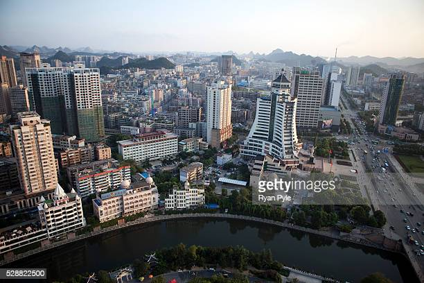 Looking down at the modern and booming city of Guiyang, the capital of China's remote Guizhou Province. Guiyang is not only the capital city of the...
