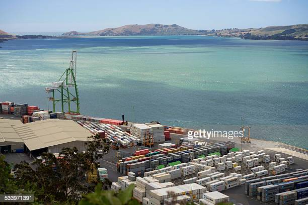 Looking down at the Port of Otago container terminal and towards the entrance to Otago Harbour. Port Chalmers, New Zealand. January 18 2015