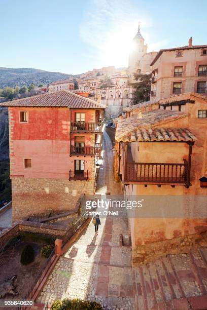 Looking down at tourist walking through old town streets, Albarracin, Spain