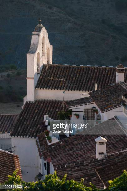 looking down at village roofs of houses and a church - dorte fjalland stock pictures, royalty-free photos & images