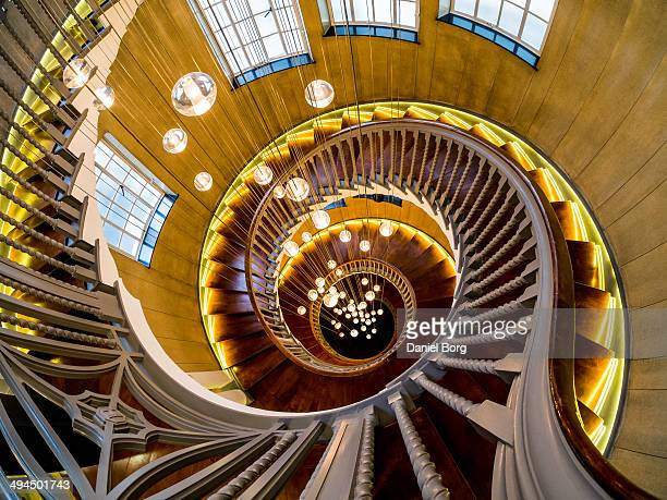 Looking down into the newly refurnished Heals department store staircase on Tottenham Court Road in London; this wonderful staircase now boasts a 64...