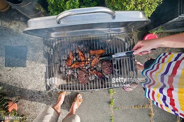 looking down on a barbecue - tongs work tool stock photos and pictures