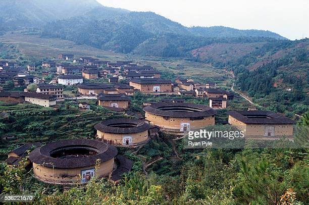 Looking down on a cluster of traditional Hakka Tulou homes in the county of Yongding, well known as the Hakka Tulou region, in Fujian. In 2008,...