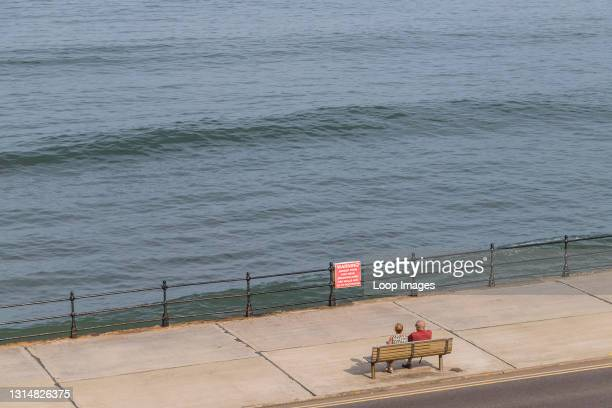 Looking down on a couple on the Scarborough promenade.