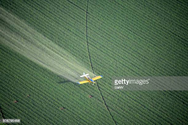 looking down on a crop duster - crop sprayer stock pictures, royalty-free photos & images
