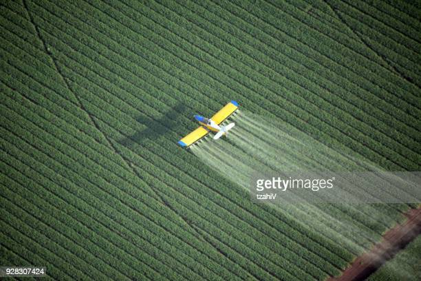 looking down on a crop duster - food contamination stock photos and pictures