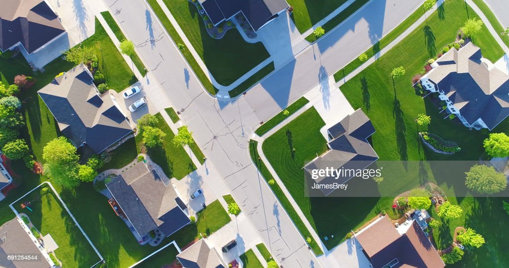 Looking down on beautiful suburban homes, Springtime aerial view. : Stock Photo