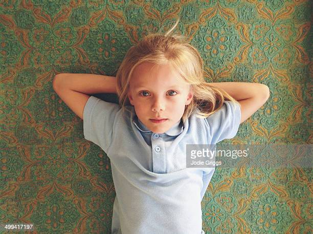 looking down on child laying on back - lying down stock-fotos und bilder