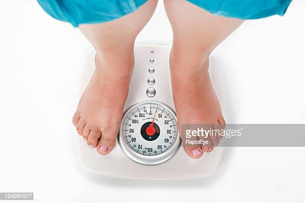 looking down on dial of scales at weigh in time - fat legs stock photos and pictures