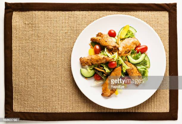 Looking down on low-carbohydrate feast of Tandoori-spiced chicken and salad