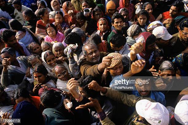 Looking down on part of the huge crowd of pilgrims reaching out for prasad from the priests who have come to pay their respects at the temple for the...