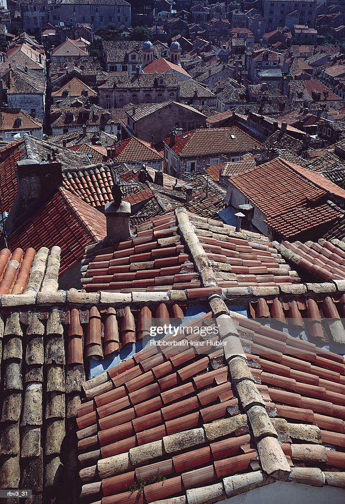 looking down on red shingled houses with chimneys rising : Foto de stock