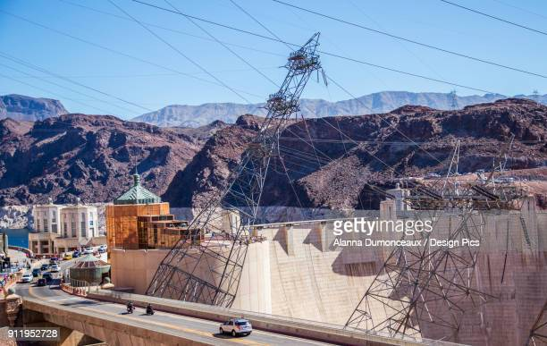 Looking Down On The Hoover Dam To See The Roadway Across The Dam And The Unique Construction Of The Electric Power Lines That Connect Through The Hydroelectric Dam