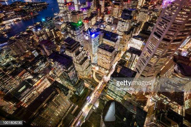 looking down on the vivid lights of sydney city business district at night from the observation deck of sydney tower - dusk stock pictures, royalty-free photos & images
