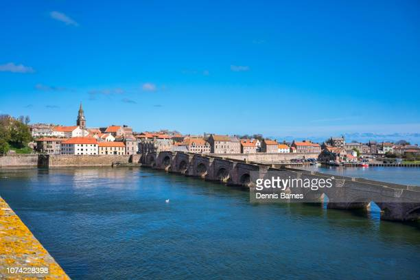 looking down river tweed to berwick old bridge, berwick upon tweed, north northumberland, england, - northumberland stock pictures, royalty-free photos & images