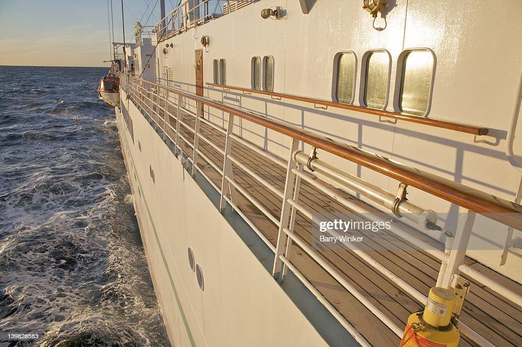 Looking Down Staircase Toward Wood Door And Teak Deck Aboard Wind - Wind spirit