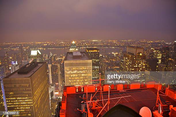 Looking east from Top of the Rock at Rockefeller Center towards Midtown West, the Hudson River and New Jersey at dusk, New York, NY