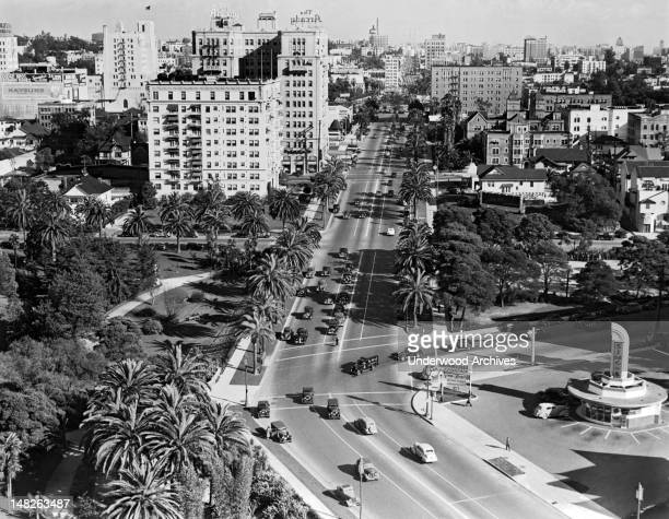 Looking east on Wilshire Blvd at Hoover St with Simon's Drive-In in the lower right and the Arcady Hotel a couple of blocks up on the left, Los...