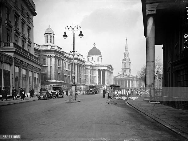 Looking east towards the Church of St Martin-in-the-Fields, Westminster, London with the National Gallery on the left and Canada House on the right....