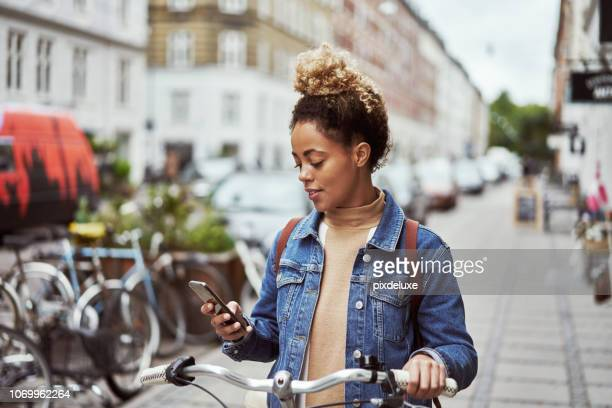 looking for bike shops nearby - mobile app stock pictures, royalty-free photos & images